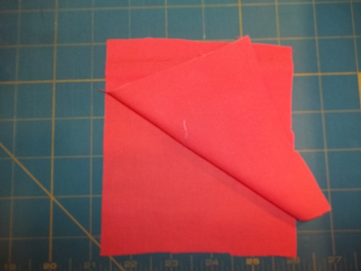 Two pieces of fabric, right sides together, ready to be pieced (sewn) together.