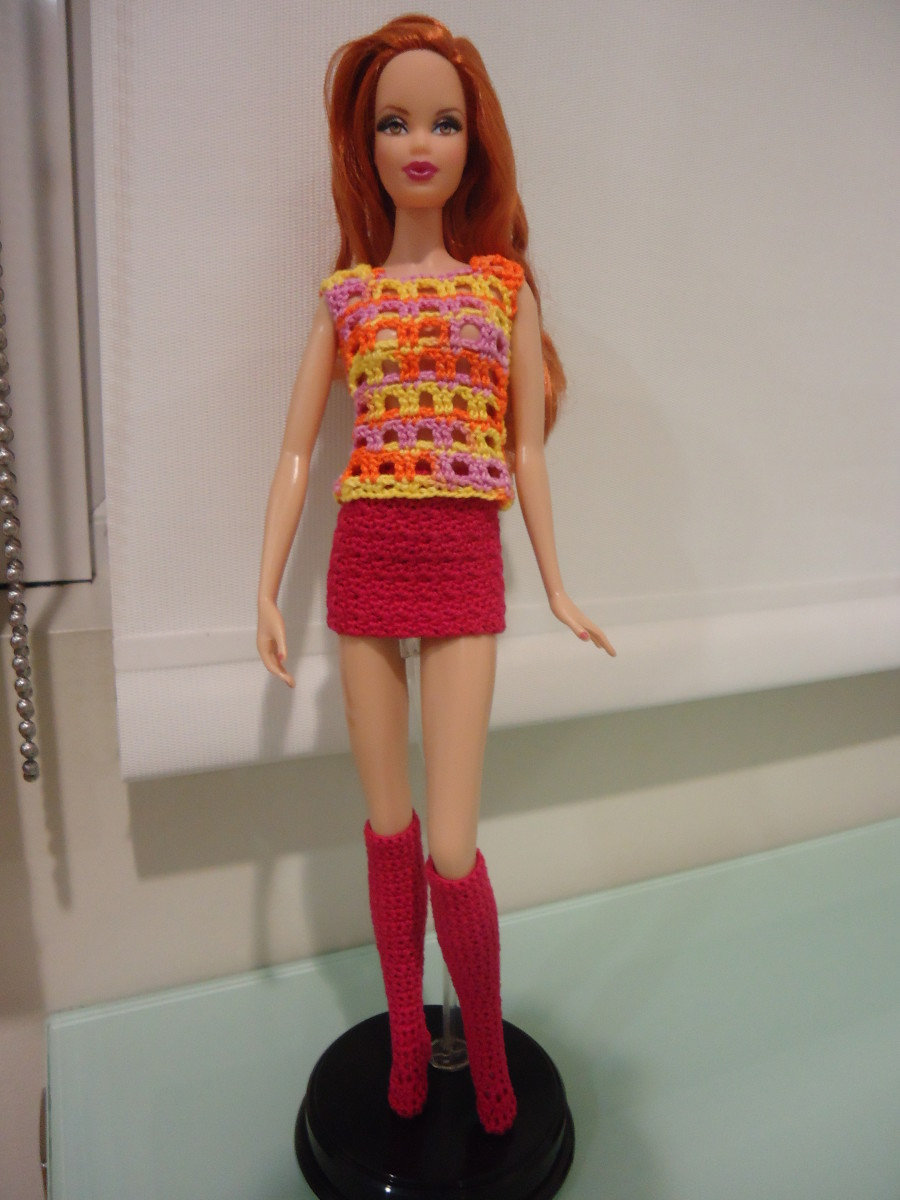 Here's Barbie modeling a cute outfit with her knee-high socks.