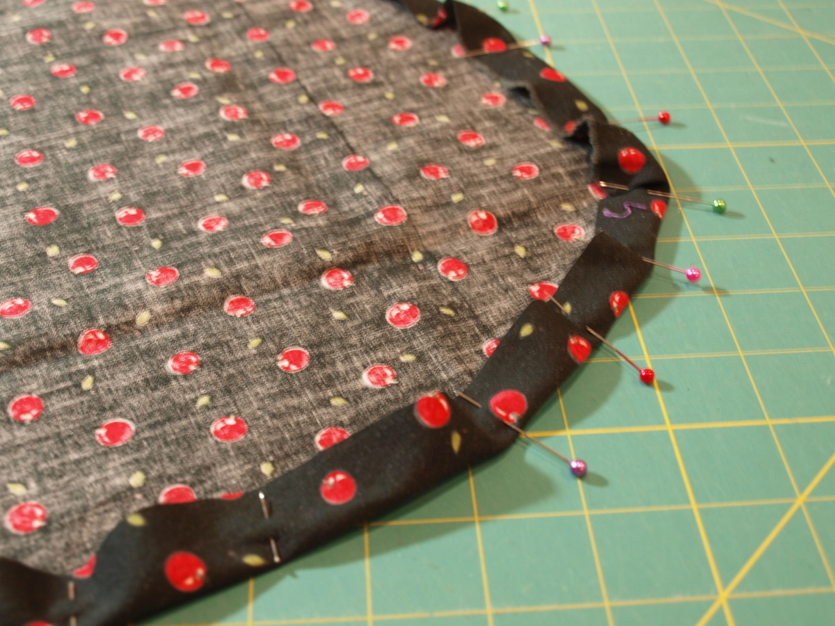 """Fold the edges over about 1"""" and pin."""