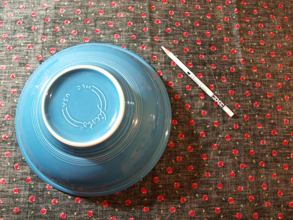 "Lay the bowl on the fabric and draw a circle around the rim, adding about 2"" around the outside."