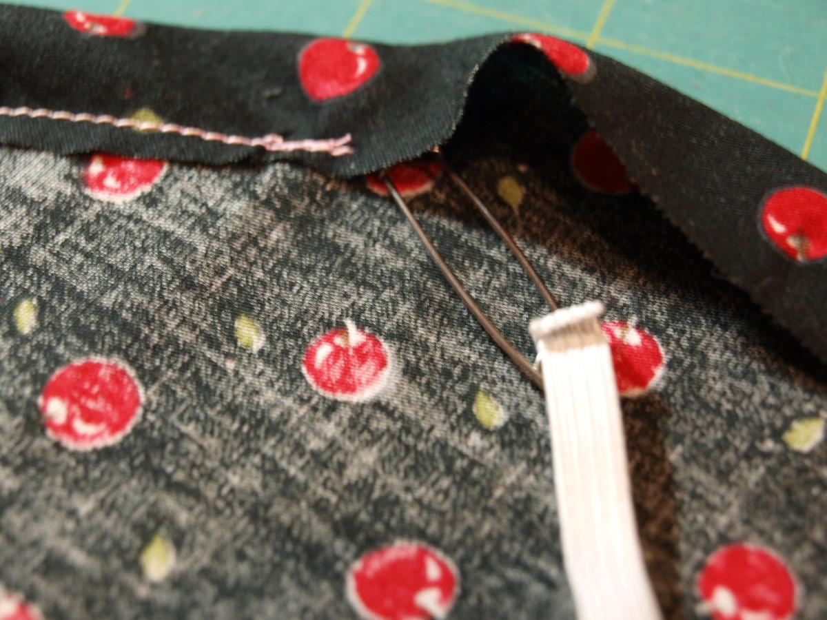 Feed the elastic through the sewn edge.