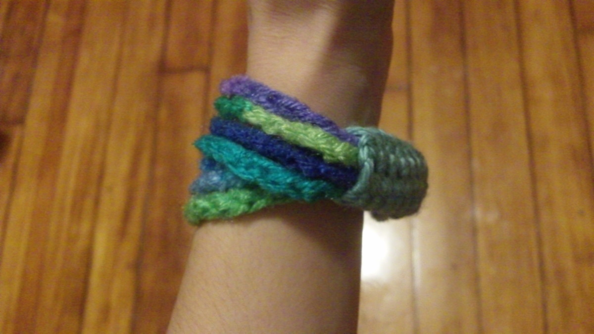 Multi-coloured chain stitch bangle with band.