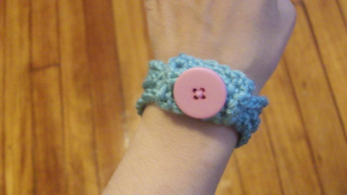 Chain stitch bangle with button.