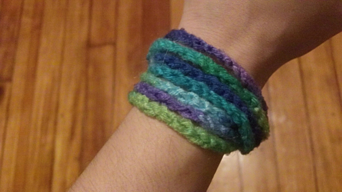Crocheted bangle bracelet.