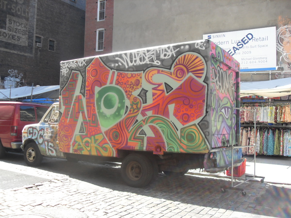 A truck covered in graffiti in New York City