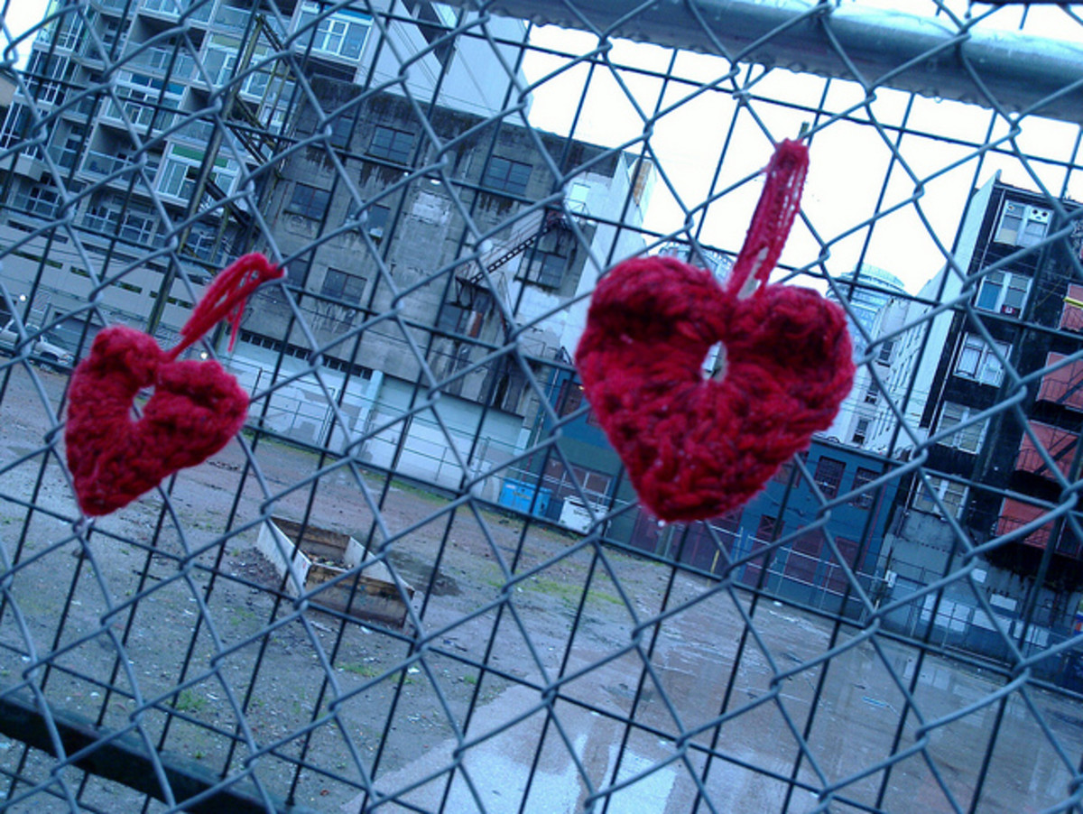 Yarn bomb hearts at an industrial site.