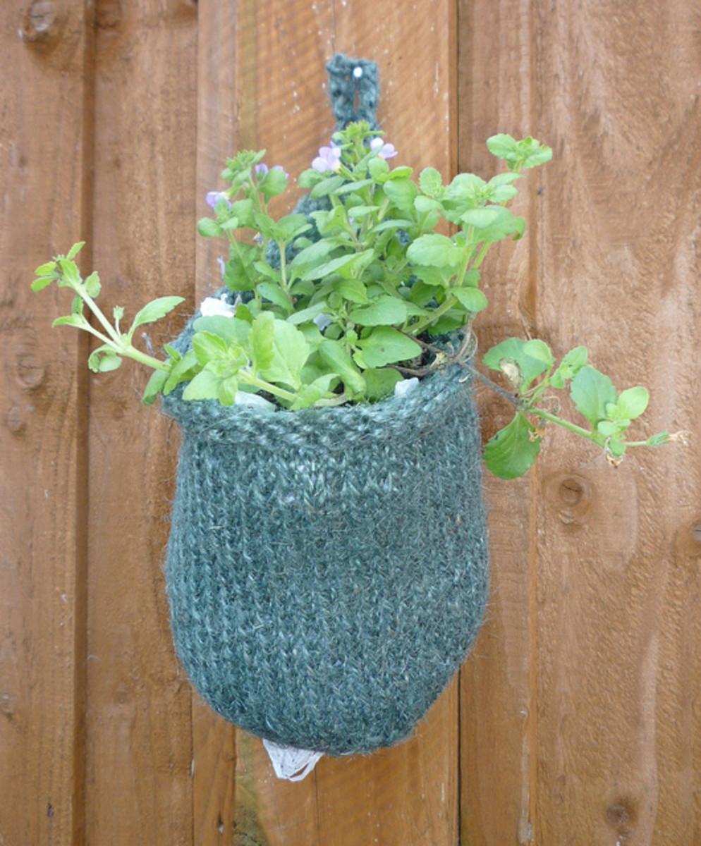 Knit yarn bomb planter