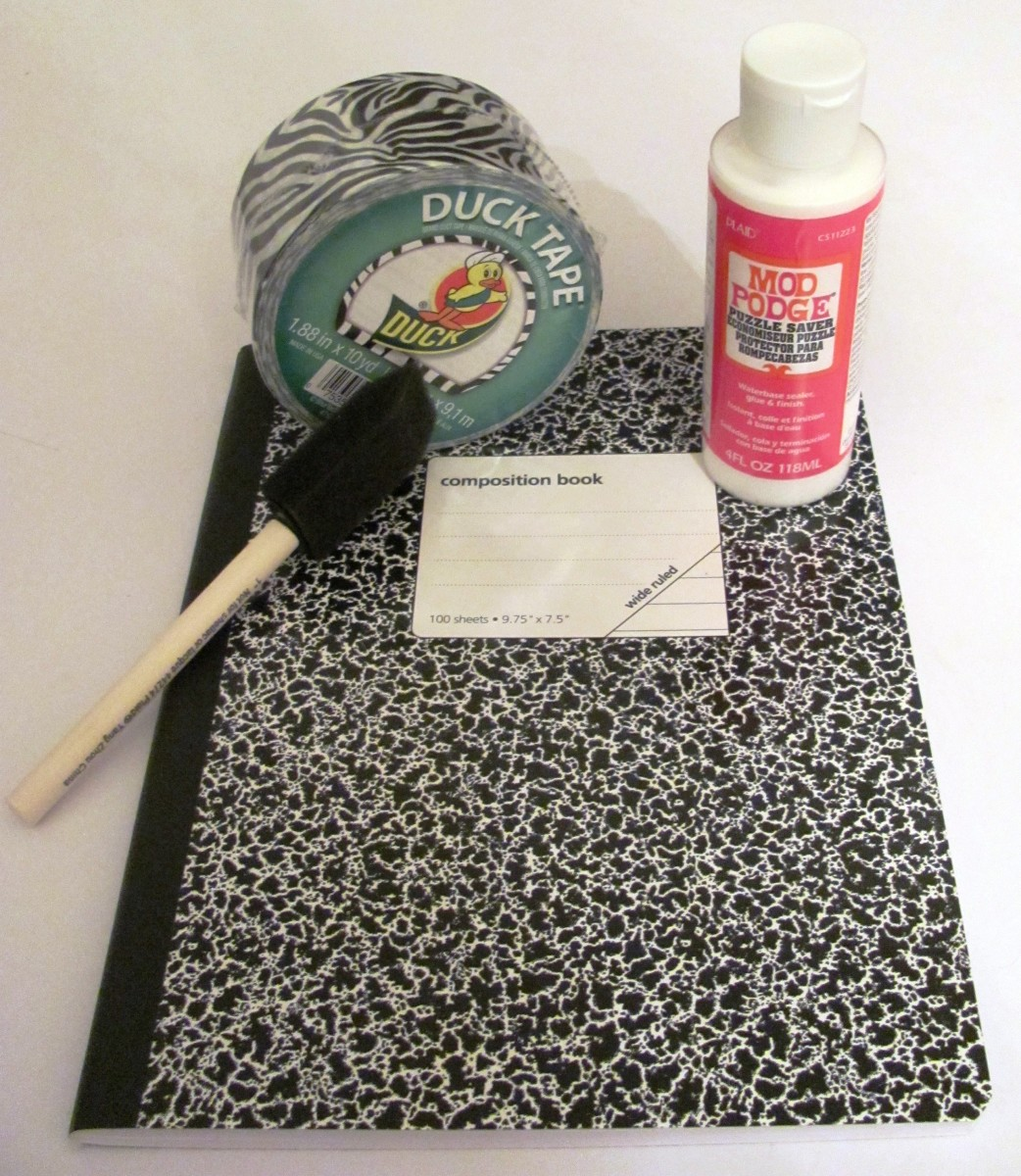 Anyone can transform a plain composition book using photos and a few basic craft tools,
