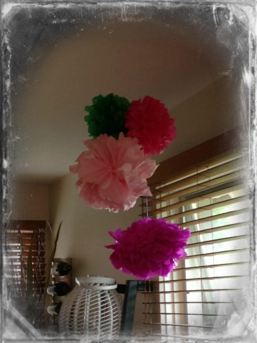 Tissue Paper Flowers Suspended From the Ceiling