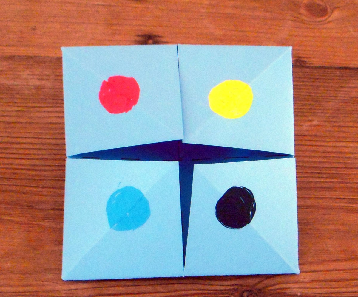 Make a different colored dot on each square flap. (This is the front side of the folded paper.)