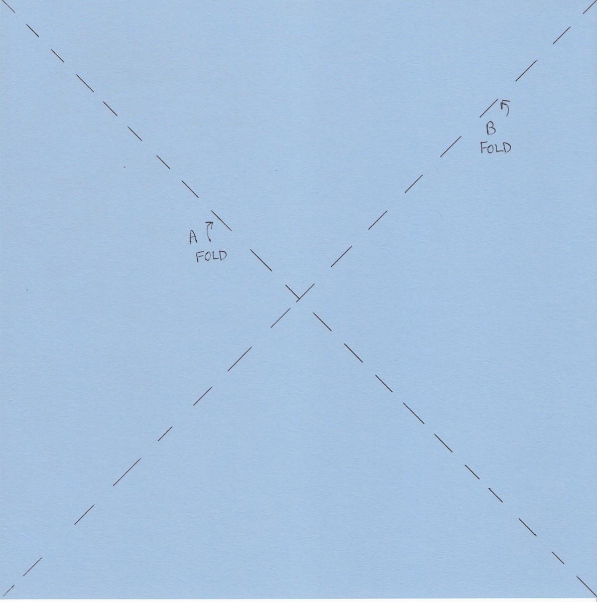 Fold diagonally and unfold along both A and B diagonal lines.