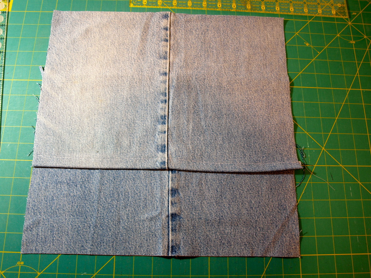 This is what the back of the pillow cover will look like.  Pin on the left and right sides where the fabric overlaps.