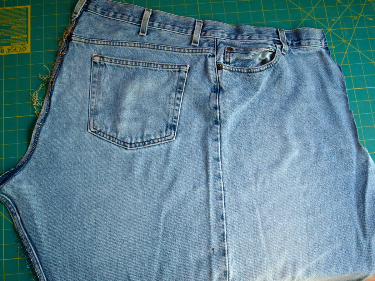 One half of a pair of blue jeans after they have been taken apart.  The center seam is the seam that runs down the outside part of the leg.