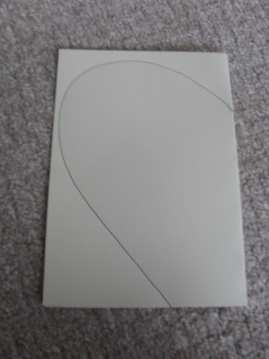 How to make an easy diy plague doctors mask with lesson ideas for start a curve that goes up and around to the top of the card then it should come back down and around until it reaches the bottom right hand corner of the maxwellsz