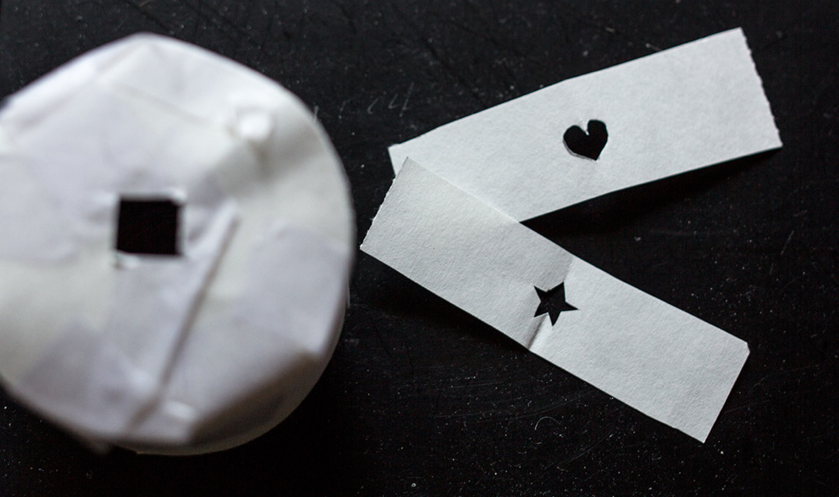 DIY interchangeable paper that slips over your camera's lens to change the Bokeh's shape.