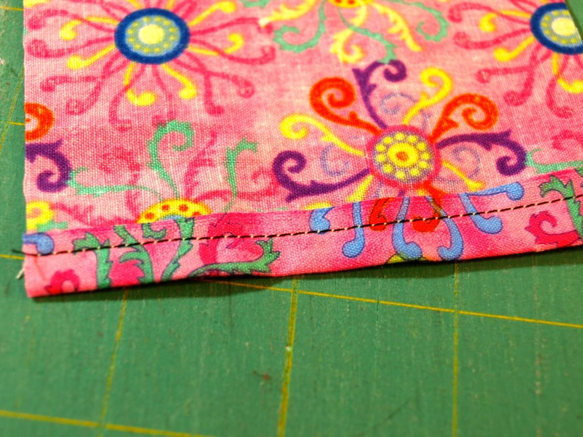 Hem both edges of the sash.