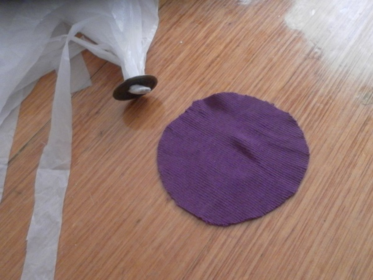 Use a small piece of fabric to wrap around the coin and tape the fabric in place.