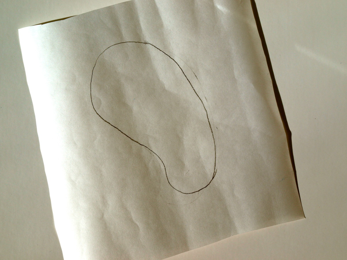 Sketch your design on freezer paper.