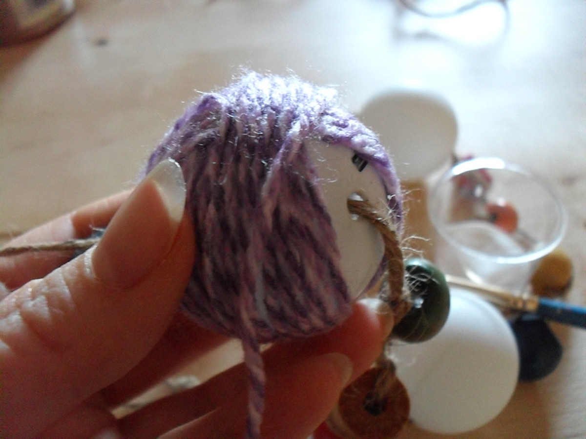Begin wrapping the yarn around the ball.