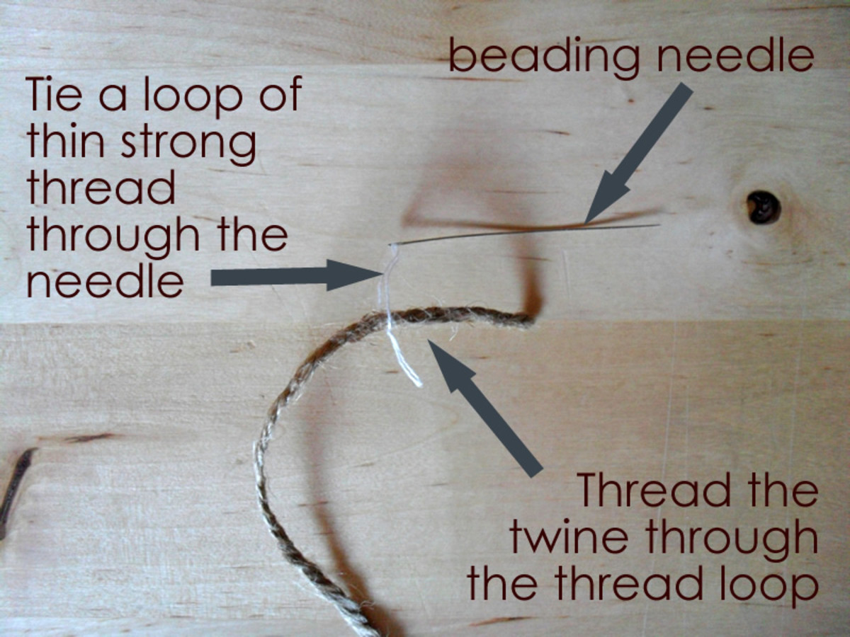 Use a long beading needle to thread the twine.