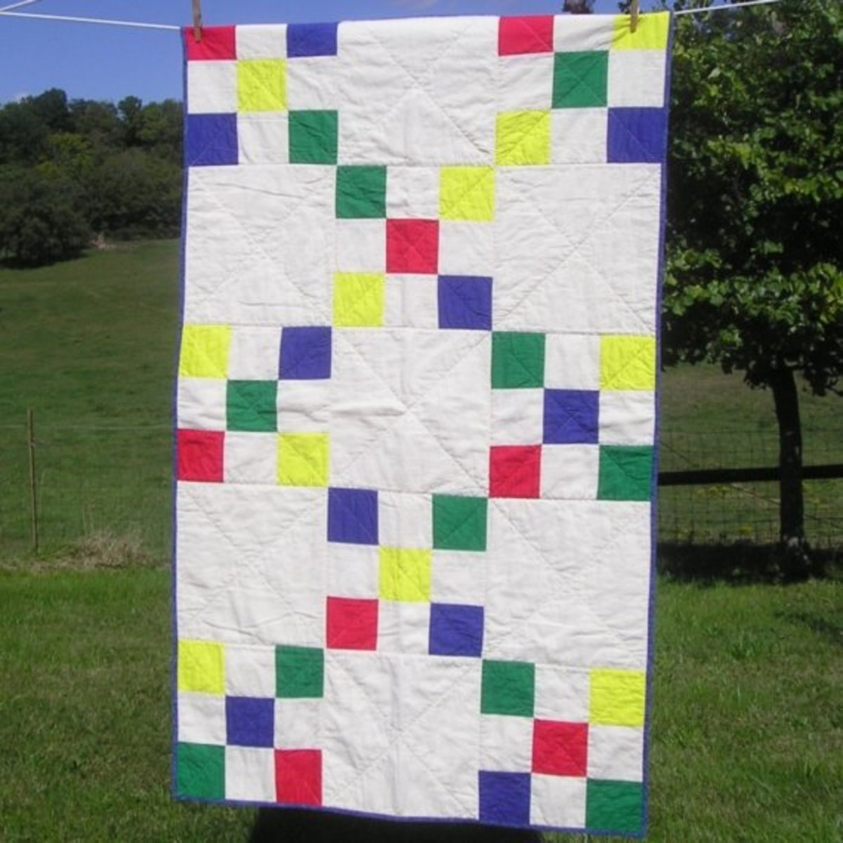 Turn your nine-patch blocks into a simplified Irish chain quilt. Just alternate nine-patch blocks with solid setting blocks cut to the same size.