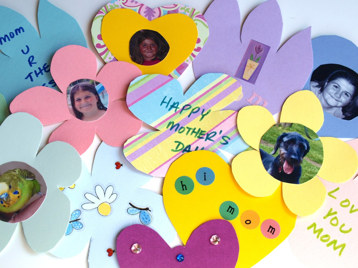 Use photos, stickers and other decorations, to adorn the paper shapes.
