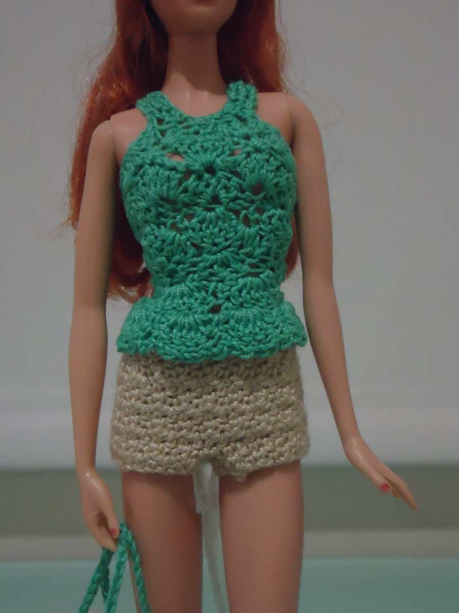 Close-up view of the Barbie Peplum Tank Top