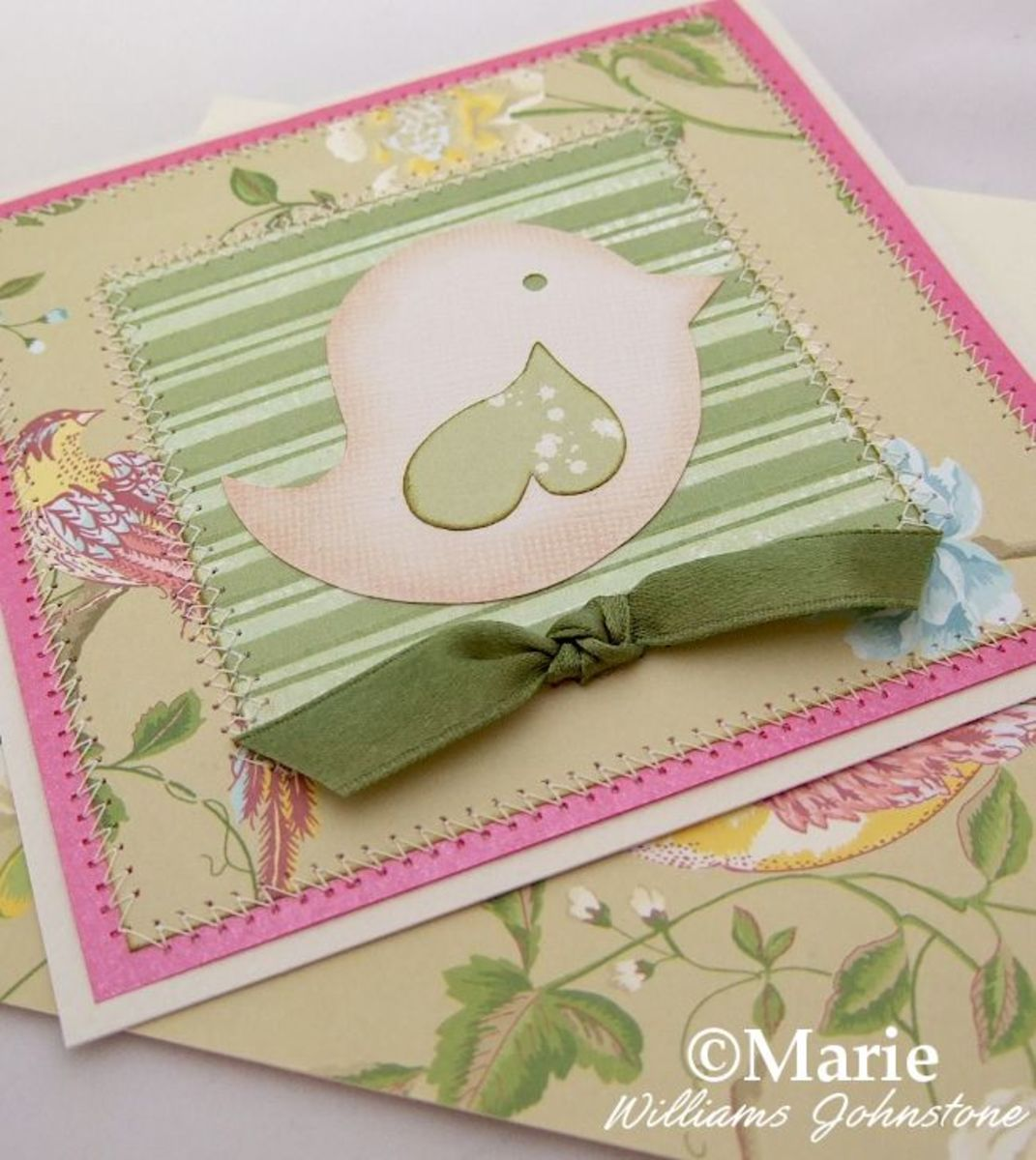 Whimsical spring bird design on a handmade card in greens and pink