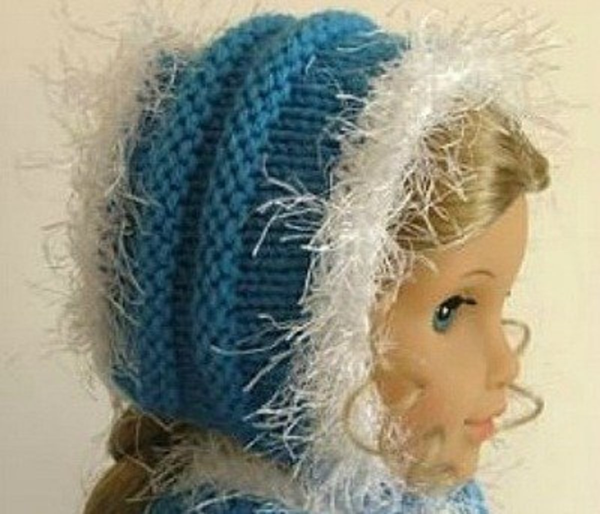 Faux fur-trimmed knitted cap