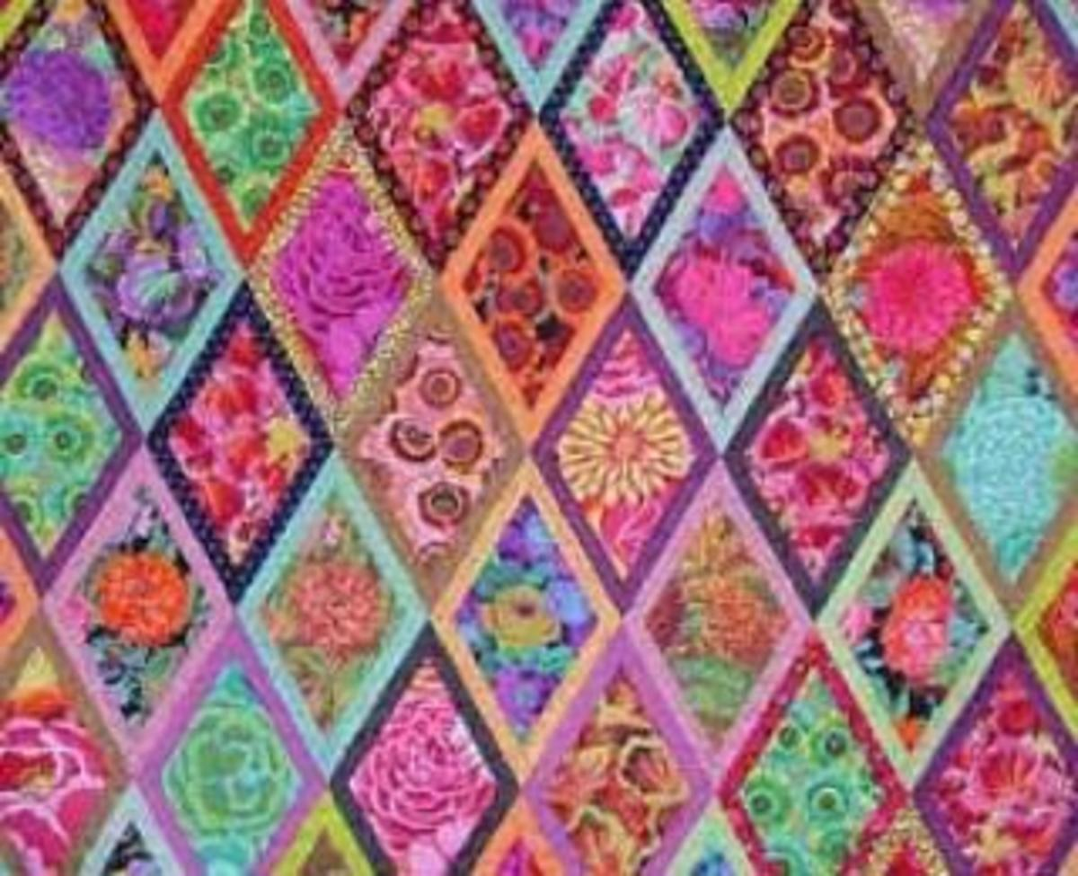 This printed batik fabric belongs to a collection designed by Kaffe Fassett.