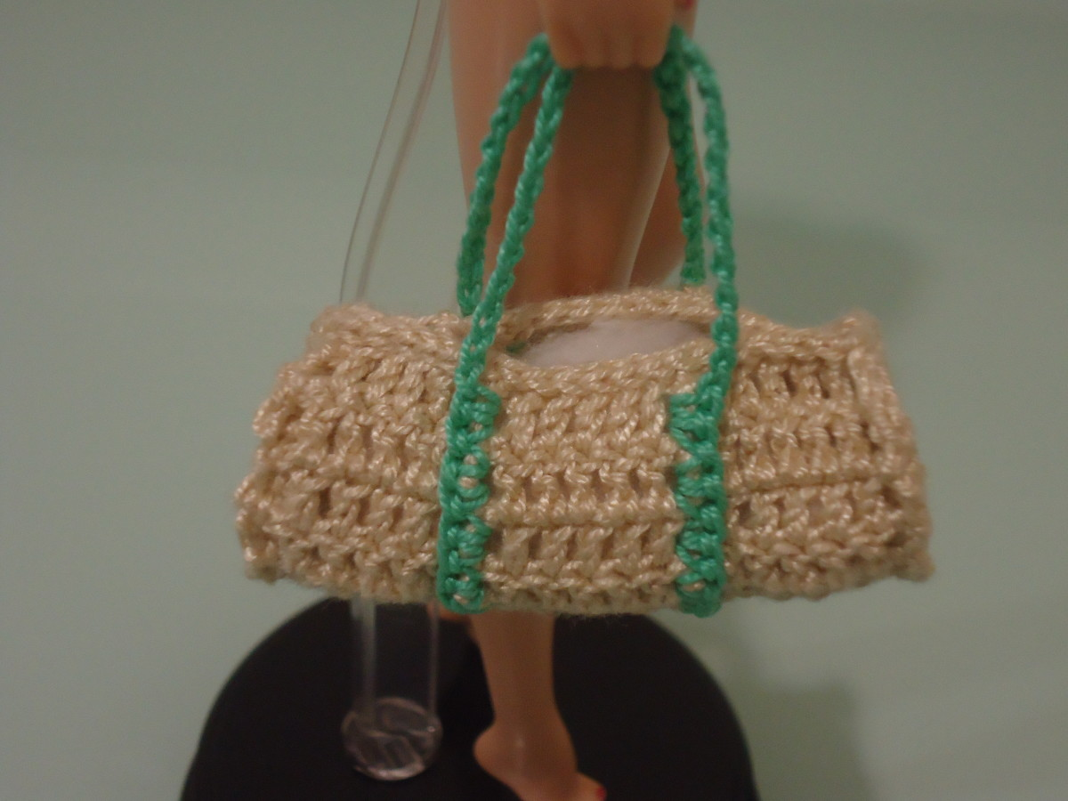 Close-up view of the Barbie duffel bag. You can see the cotton balls peeking out.