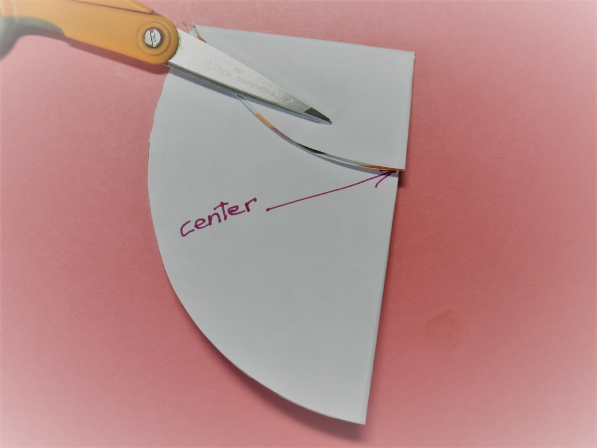 Bring one side to center and crease