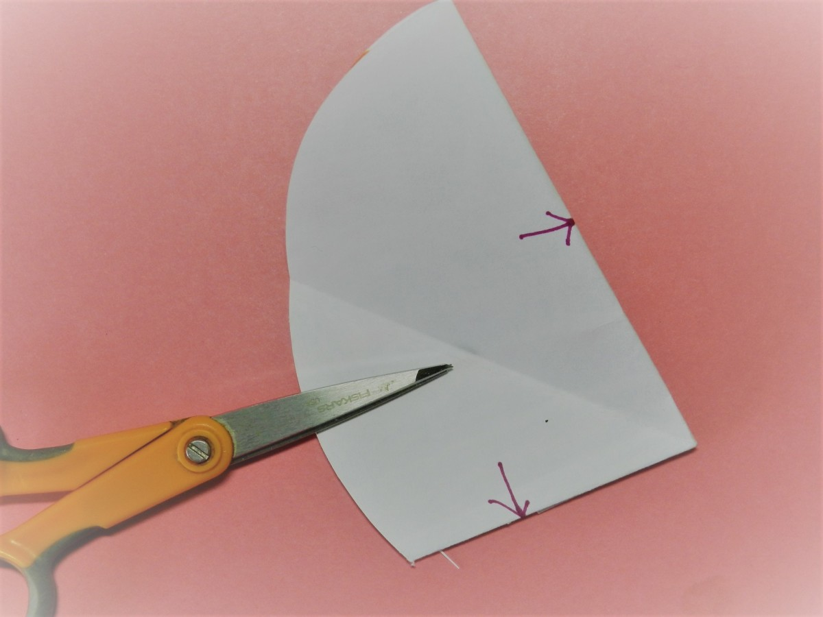 Turn over and match at arrows and crease so that you have a pie shape