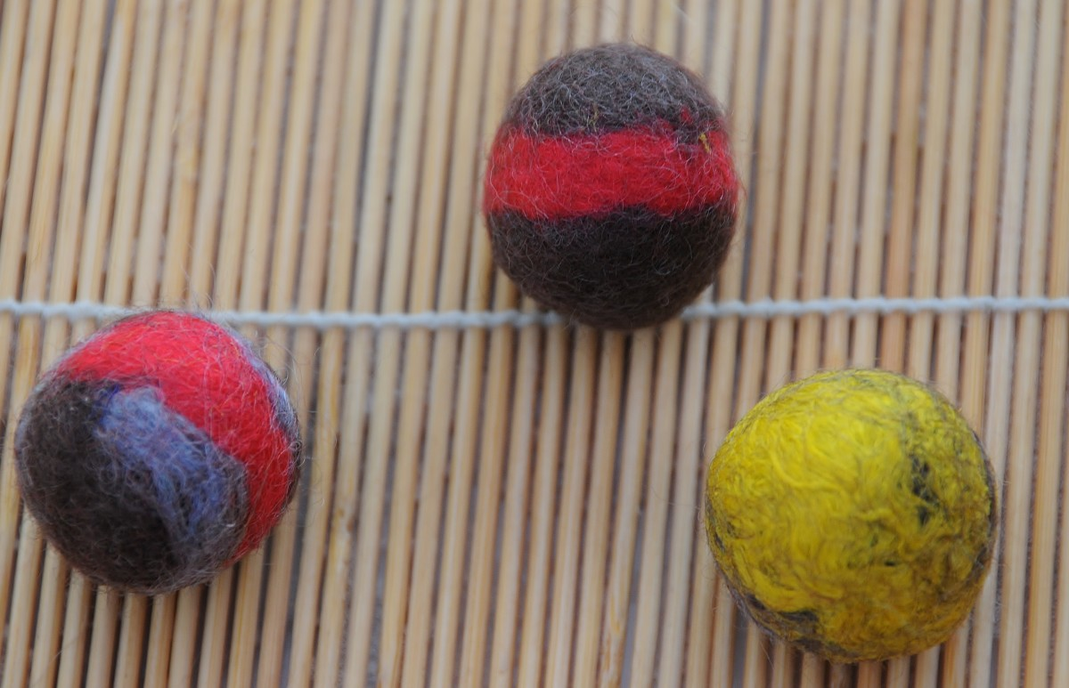 A final roll on a tea towel until the bead becomes firm under the fingers.