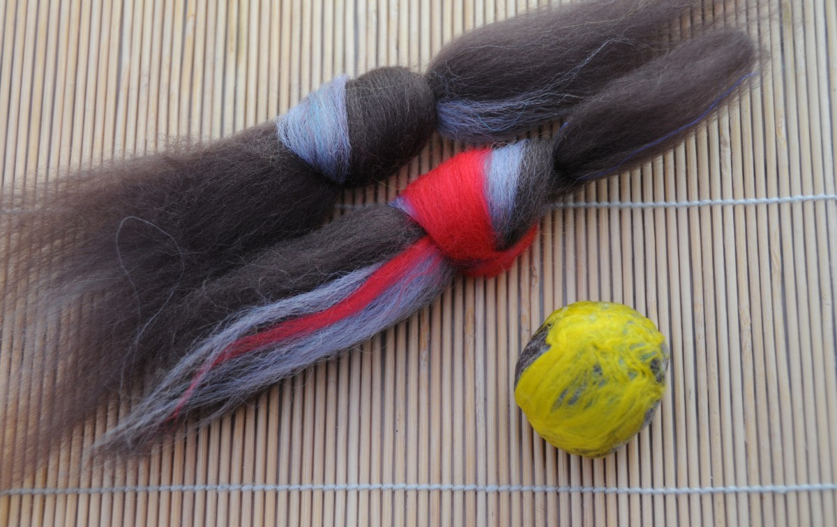 One incomplete ball and two pieces of knotted roving