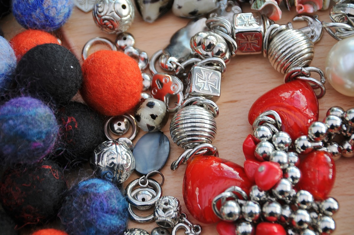 Felt Beads and recycled charms from a bracelet