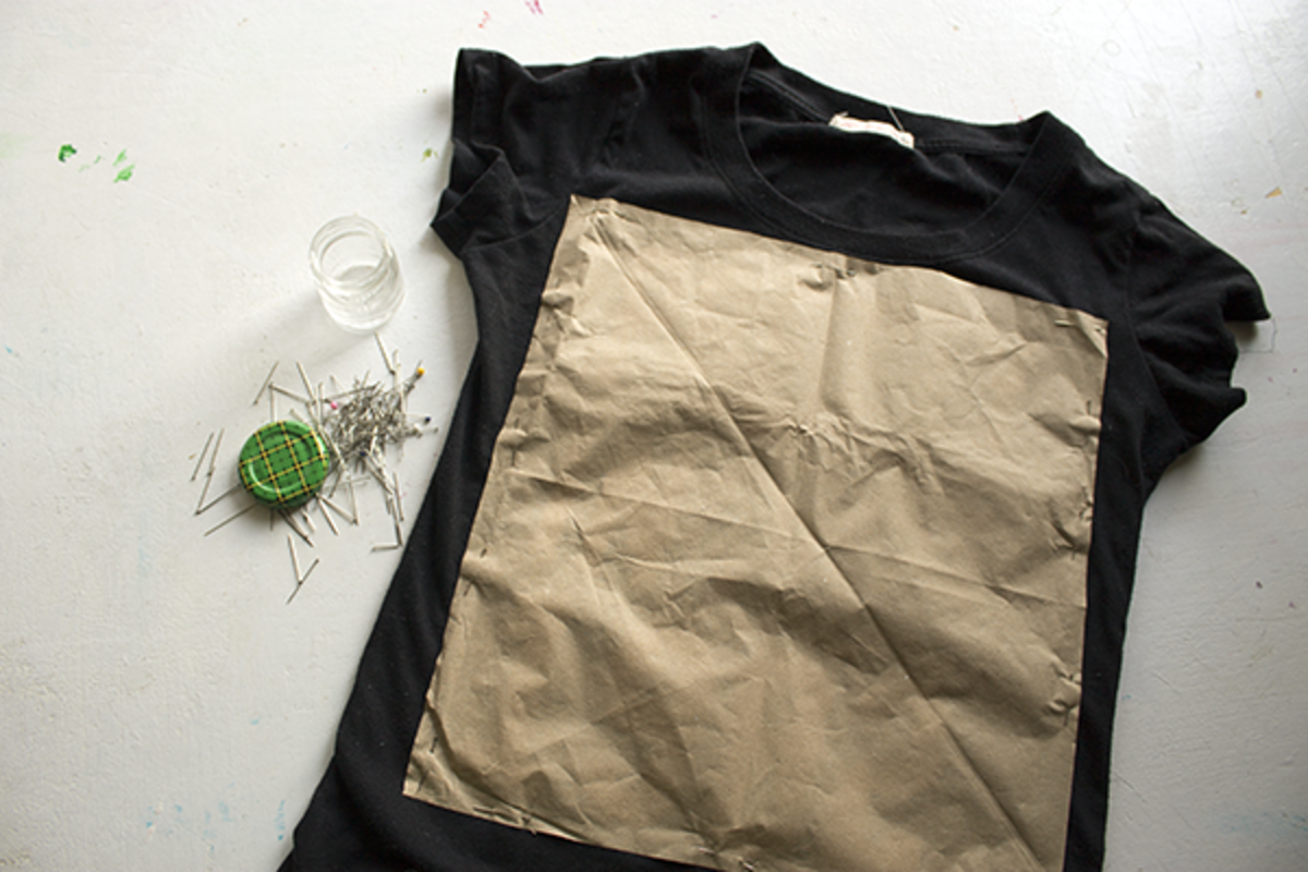 Pin the paper pattern to the shirt, making sure to go through both layers.