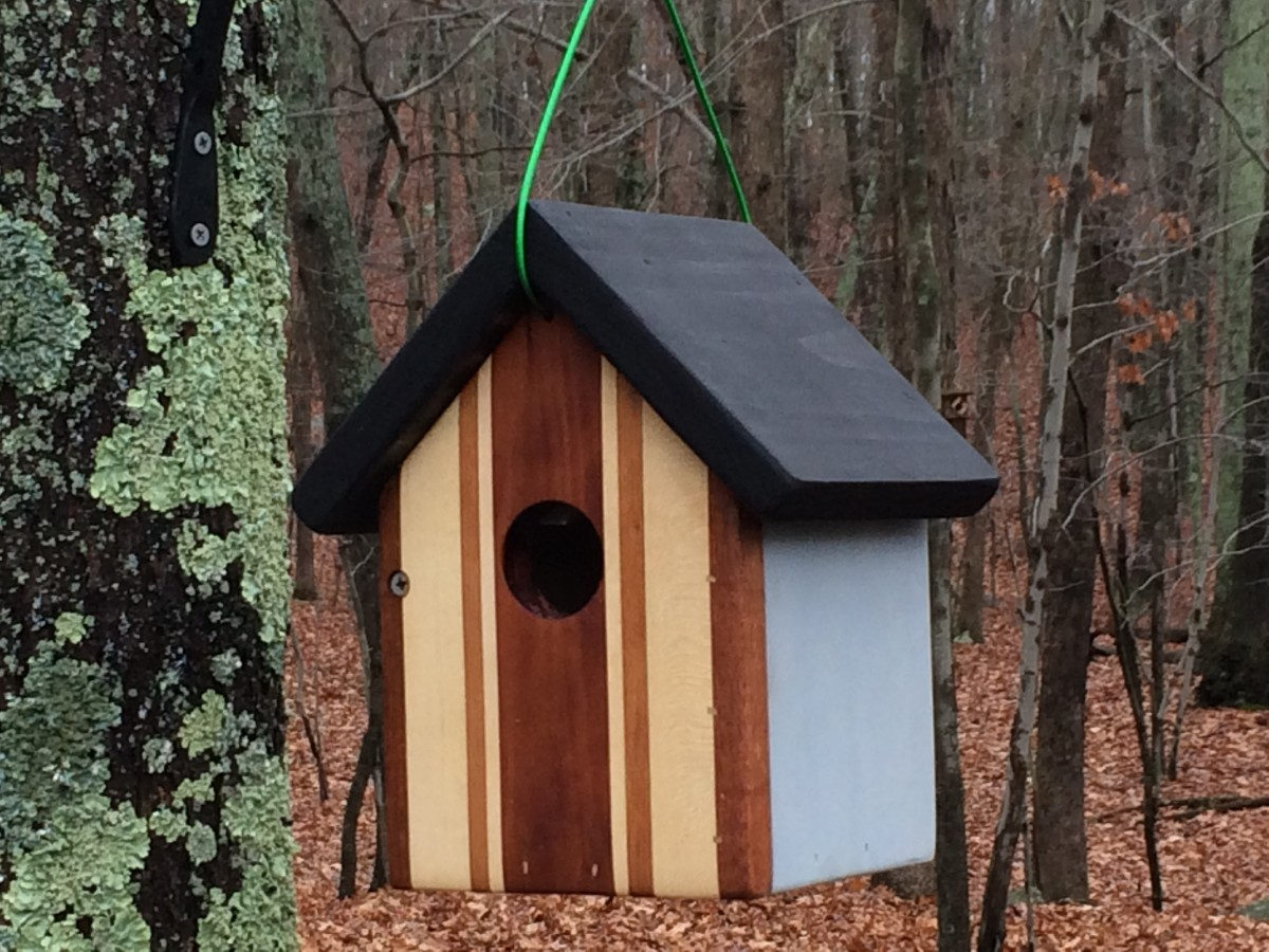 The front of this birdhouse is made from pieces of mahogany, maple, teak and oak.