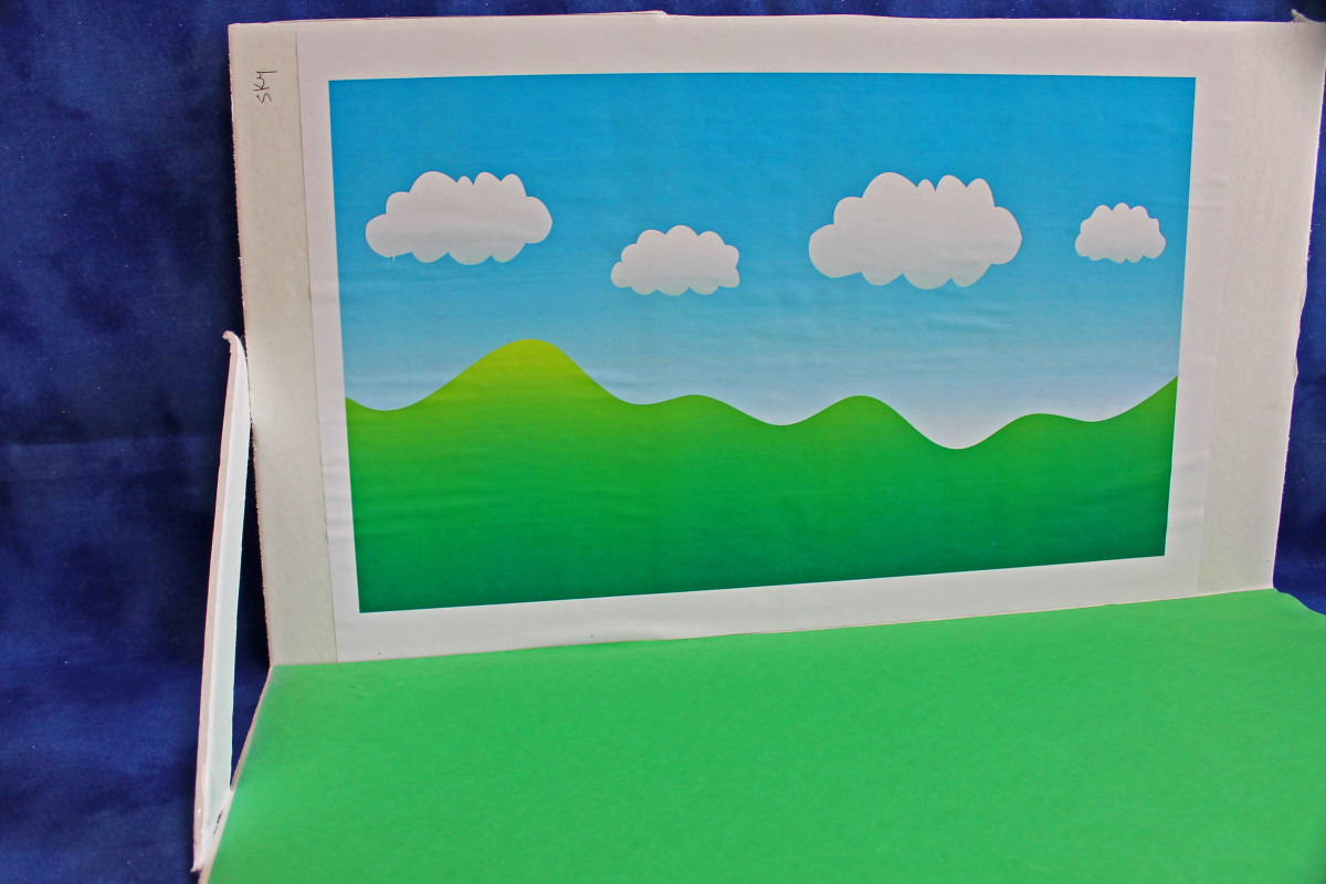 You can use foam board as a base for your diorama. Print out pictures for the backdrop.
