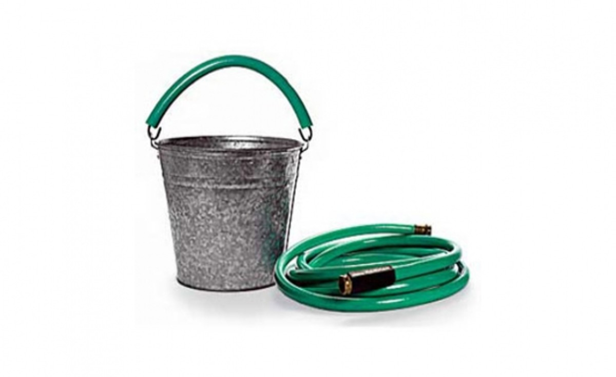 A metal bucket is much more comfortable to use when the handle is fitted with a length of garden hose.