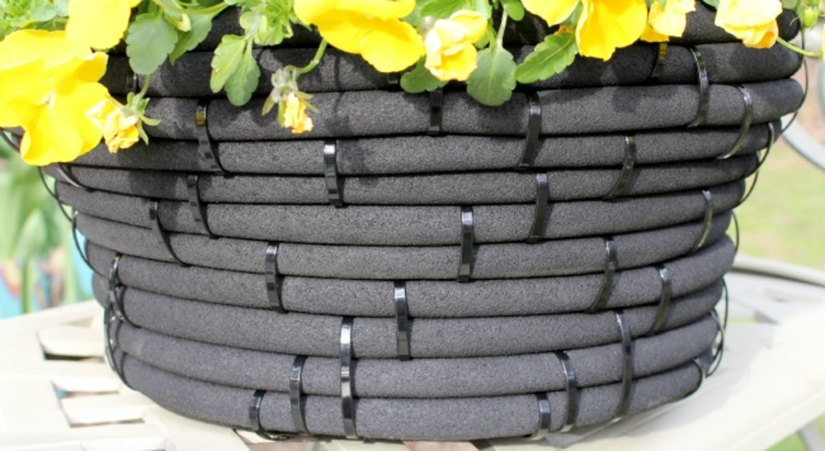 Large garden hose planter.