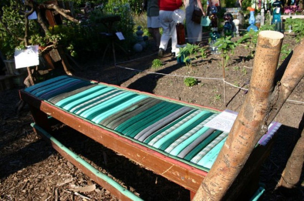 Old bench frame with new garden hose seat.