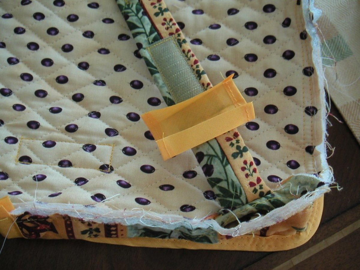 There was no way to enclose both sides of fabric around this strap without adding another piece of bias tape.
