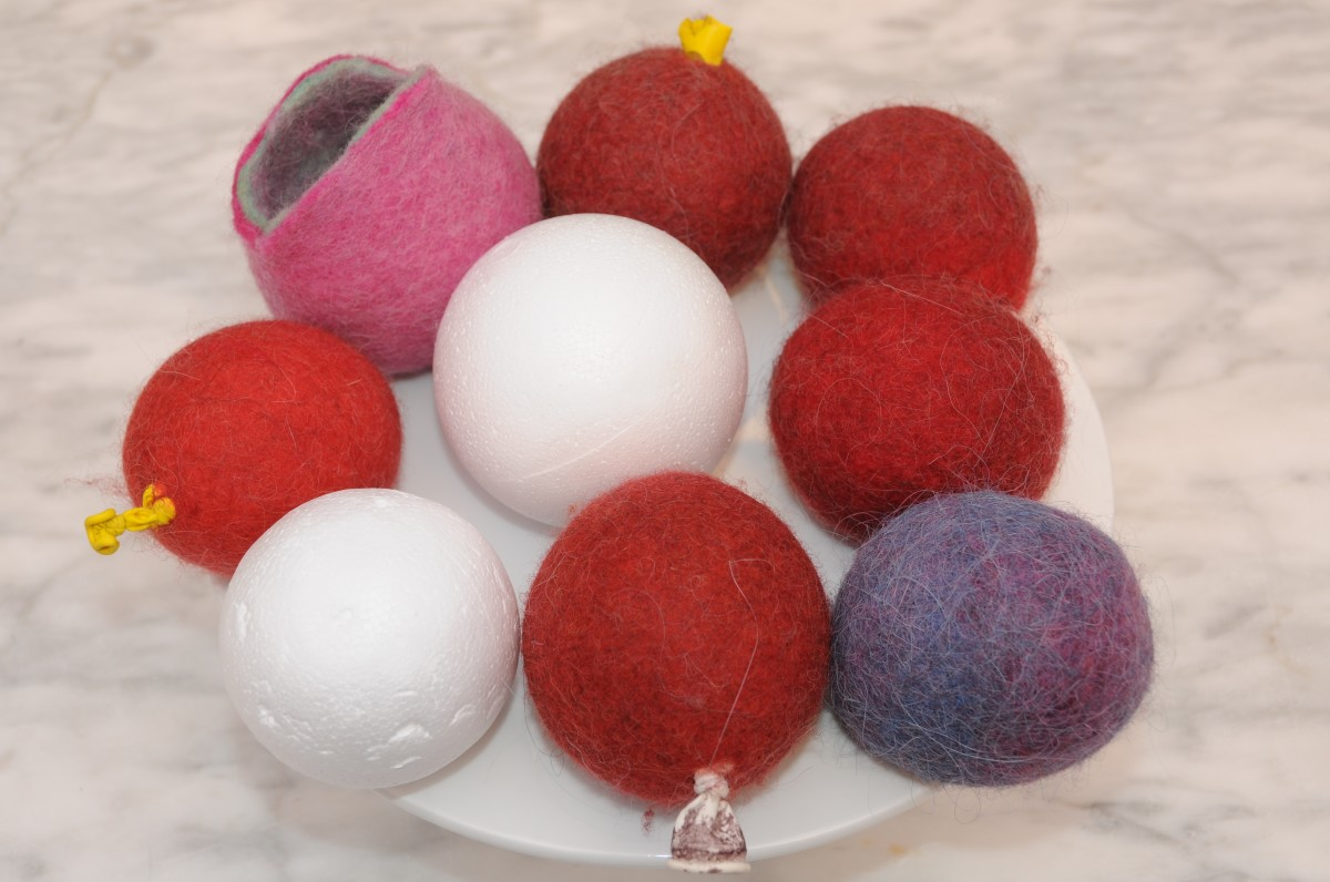 A group of wet felted coin purses which were all made at one sitting.