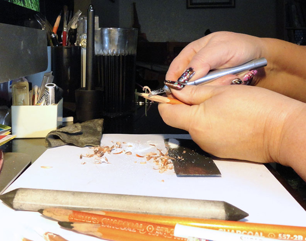 Sharpening my charcoal pencils with an X-acto knife.