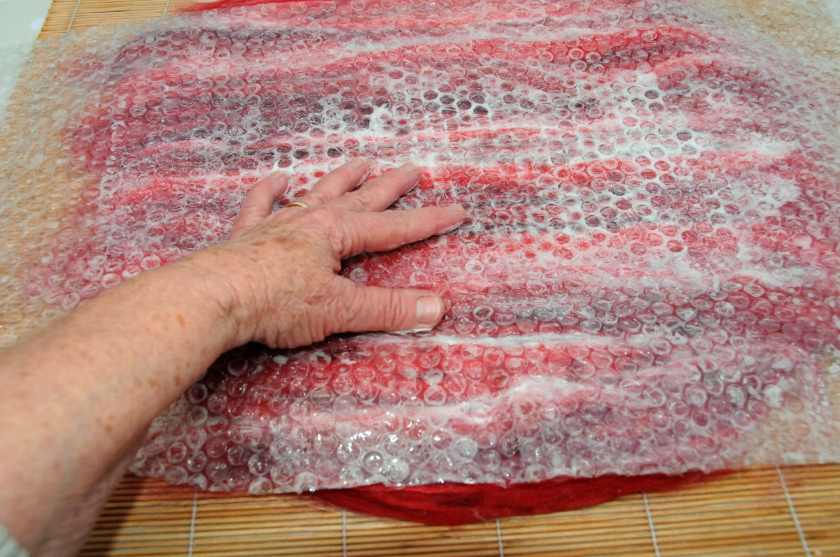 Cover the fibres with bubble wrap and a little surface water.