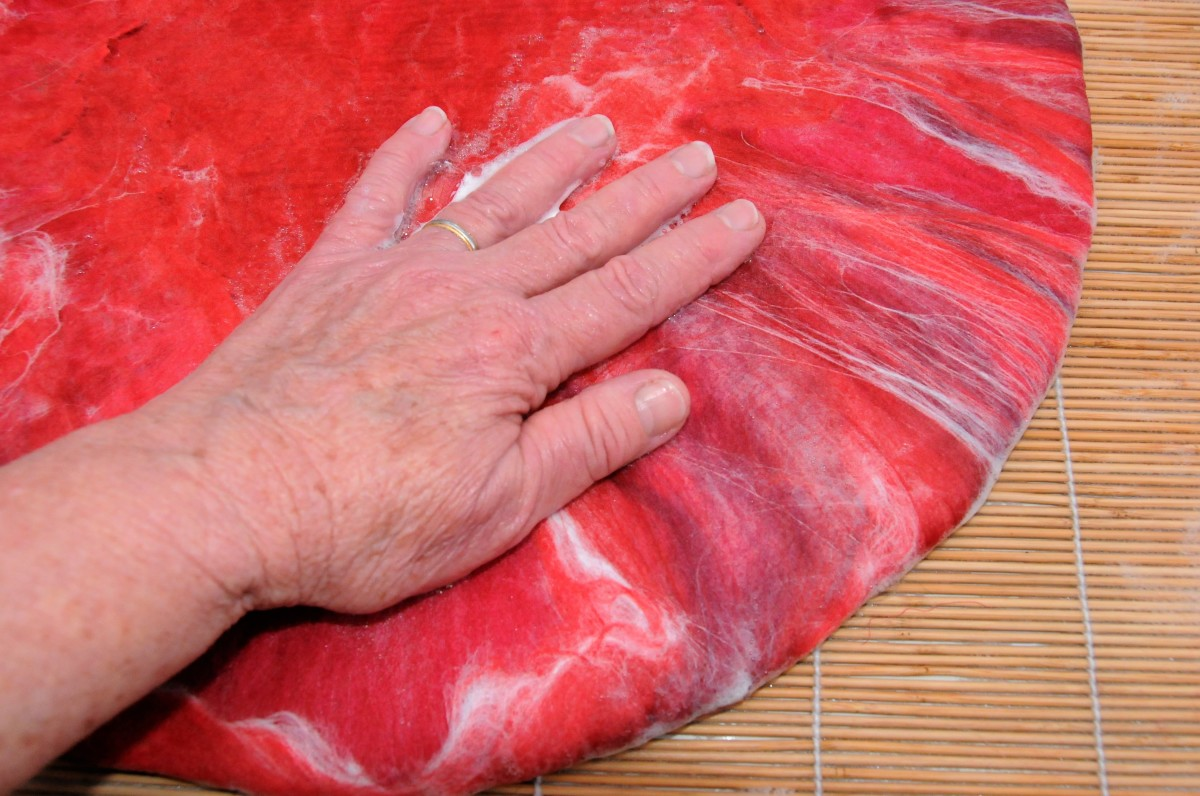 Fold over the edges and wet with hot soapy water.
