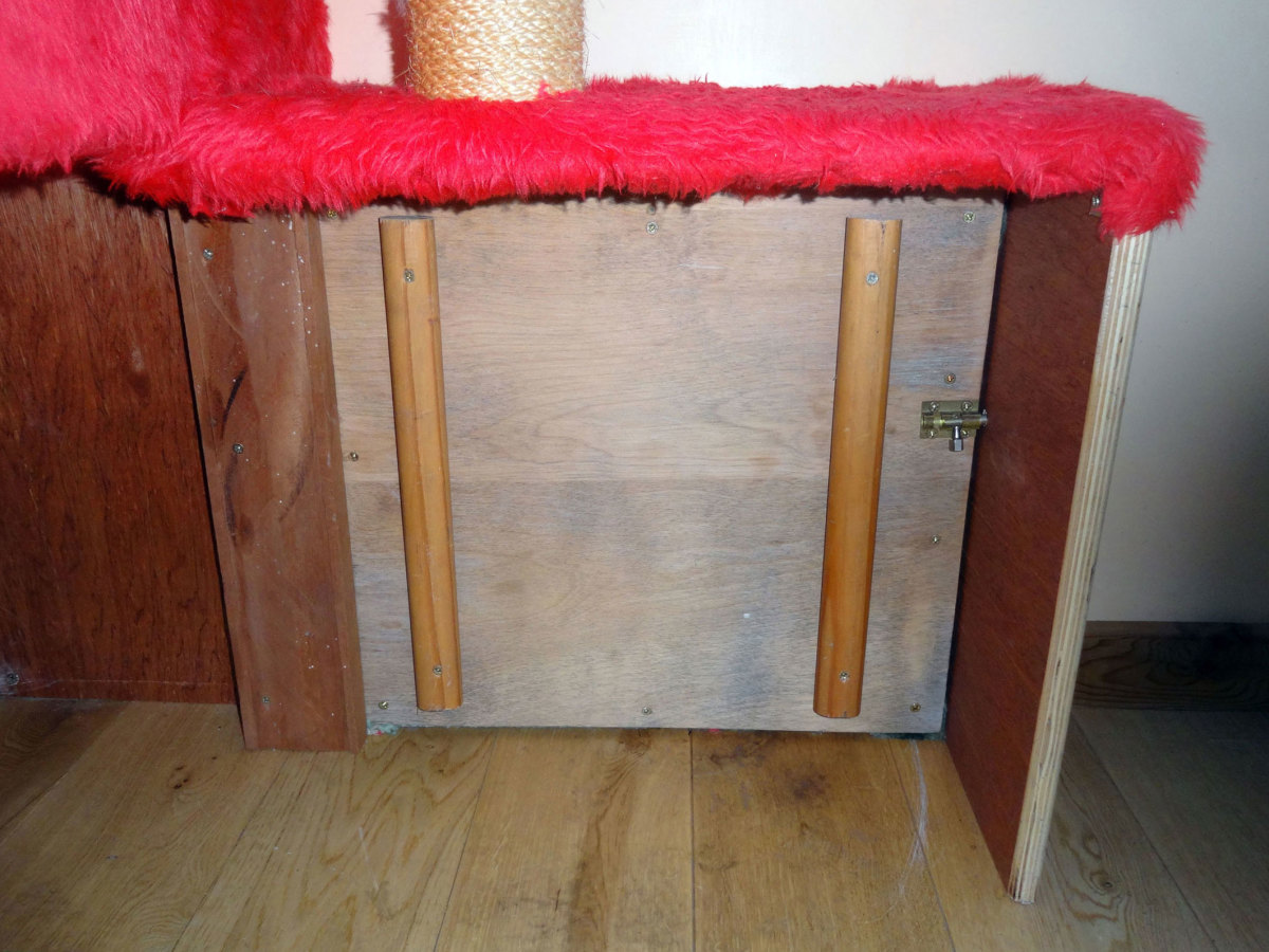 Cat flap insulator upholstered with carpet to keep the draughts out.