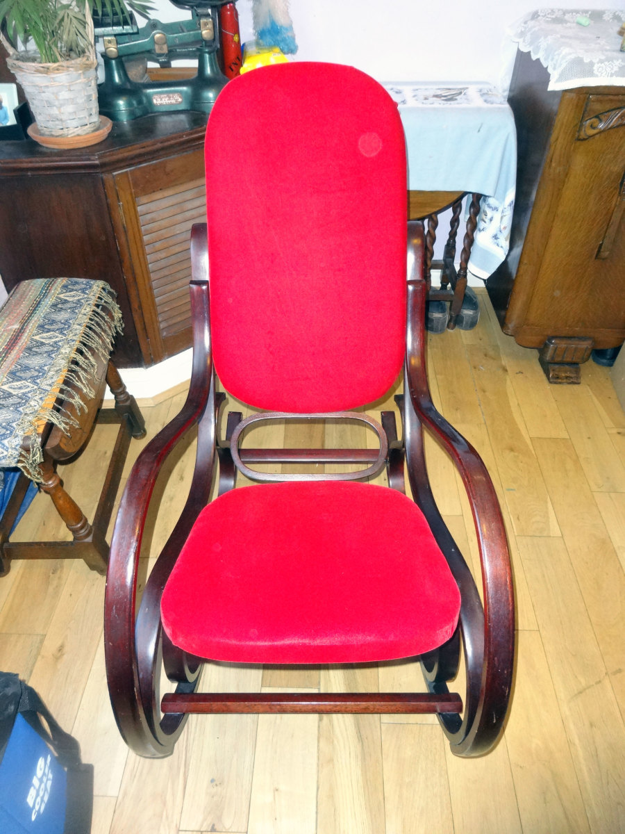 Rocking chair once upholstered.