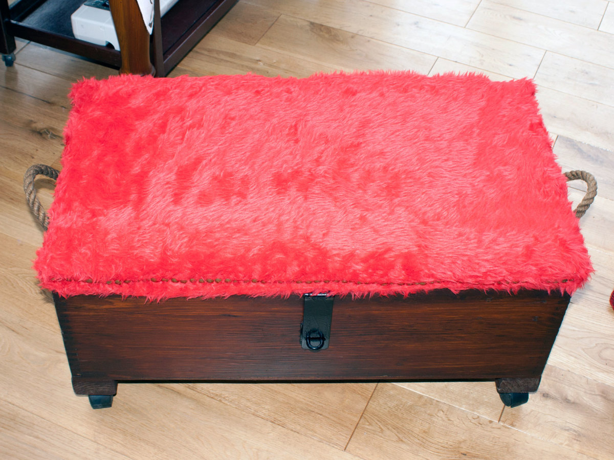 Foam covered with red faux fur.